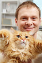 Men and cat Stock Images