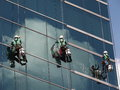 Men cleaning glass building Royalty Free Stock Photo