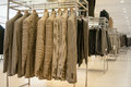 Men clothes stands jackets in a modern store Royalty Free Stock Photo