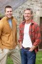 Men in country garden Royalty Free Stock Photos