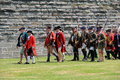 Men dressed in soldier`s uniform, during the French and Indian War re-enactments, Fort Ontario, New York, 2016 Royalty Free Stock Photo