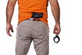 Men with a gun and handcuffs Stock Photo