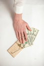Men hand got caught in mouse trap while he was stealing money closeup shot of man Royalty Free Stock Images