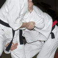 Men hands in judo fight Stock Images