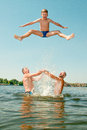 Men have thrown the boy in water Royalty Free Stock Photo
