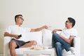 Men having argument arguing two middle aged male friend at home multiracial people friendship Stock Images