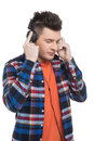 Men in headphones cheerful young man listening to the music while standing isolated on white Stock Photography