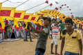 Men help to hold up a Japanese kite prior to take off on Negombo beach in Sri Lanka. Royalty Free Stock Photo