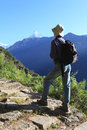 Men hiker himalaya mountains nepal walking in in fish tail as background Stock Photo