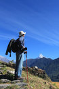Men hiker himalaya mountains nepal walking in in fish tail as background Stock Photos