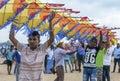 Men hold a Japanese kite on Negombo beach in Sri Lanka. Royalty Free Stock Photo
