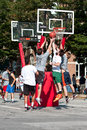 Men jump while fighting for ball in street basketball tournament athens ga usa august three battling the a on held on the streets Royalty Free Stock Photography