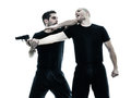 Men krav maga fighters fighting isolated two caucasian silhouette on white background Stock Photo