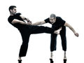 Men krav maga fighters fighting isolated two caucasian silhouette on white background Royalty Free Stock Images