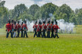 Men marching in field during reenactment morrisburg canada july across a the battle of crysler s farm on july near morrisburg Stock Photo