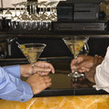 Men at martini bar. Stock Photos