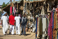 Men at the nubian village of garb sohel in the aswan region of egypt walking through many stalls selling merchandise and souvenirs Royalty Free Stock Photos