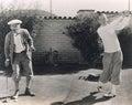 Men playing golf in backyard Royalty Free Stock Photo