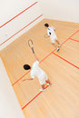 Men playing squash at the court a match of Royalty Free Stock Images