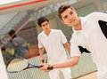 Men playing squash two a match of Stock Photos