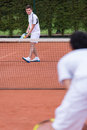 Men playing tennis a match at the court Stock Photography