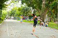 Men plays badminton using feet in ho chi minh vietnam november footbag tao dan park on noveber saigon Royalty Free Stock Image