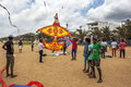 Men prepare to launch a large kite skywards on Negombo beach. Royalty Free Stock Photo