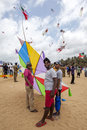 Men prepare to launch their kite on Negombo beach in Sri Lanka during the annual kite festival. Royalty Free Stock Photo