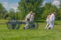 Men pulling wagon and canon morrisburg canada july a cart with a during the battle of crysler s farm reenactment on july near Royalty Free Stock Image