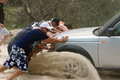 Men pushing bogged car group of australian a in the deep sand stradbroke island february Royalty Free Stock Photography