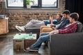 Men relaxing on sofa Royalty Free Stock Photo