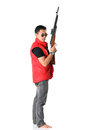 A men with rifle ferocious man standing holding his Stock Photography