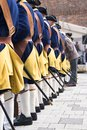 Men in a row from behind wear historical swedish soldier uniform Royalty Free Stock Photo