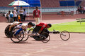 Men's 100 Meters Wheelchair Race Royalty Free Stock Photo