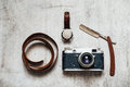 Men's Accessories , top view on a wooden background Retro camera watch razor