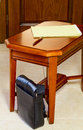 Men s bag next to the coffee table against door Royalty Free Stock Images