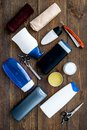 Men`s bathroom set. Cosmetics for bath, tools for brushing and grooming on dark wooden background top view