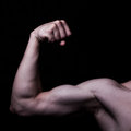 Men s biceps on a black background Royalty Free Stock Image