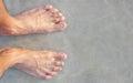 Men's feet on the beach. Royalty Free Stock Photo