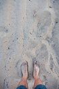 Men s feet in the hot sand Royalty Free Stock Photos