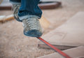 Men s feet in shoes on slackline sport are the red Royalty Free Stock Photos