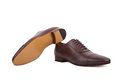 Men s lace up dress shoes designed with a slim elongated toe made from smooth brown leather on white background Stock Photography
