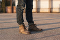 Men`s legs with jeans and boots. Hipster at sunset. Royalty Free Stock Photo