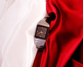 Men s mechanical watch on a background of red and white fabric Royalty Free Stock Photography