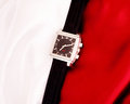 Men s mechanical watch on a background of red and white fabric Royalty Free Stock Images
