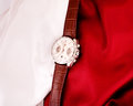 Men s mechanical watch on a background of red and white fabric Stock Photography