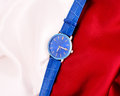 Men s mechanical watch on a background of red and white fabric Royalty Free Stock Photo