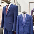 Men`s suits with shirts and ties in clothing store Royalty Free Stock Photo