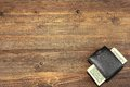 Men's Wallet With Dollar Cash On The Rough Wood Background Royalty Free Stock Photo