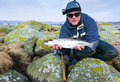 Men with silver sea trout trophy Royalty Free Stock Photo